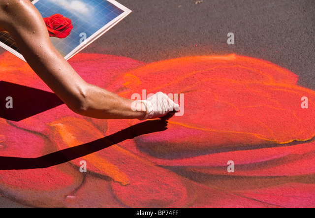 Artist at work (red rose) at the Italian Youth Street Painting Festival, San Rafael, California - Stock Image
