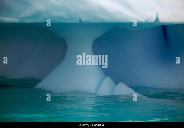 Iceberg showing wave erosion, Antarctica, January - Stock Image