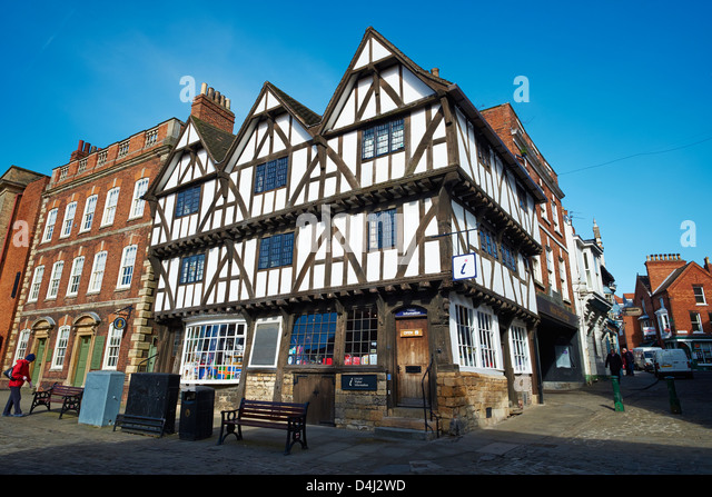 Leigh-Pemberton House a half timbered Tudor house is now the Tourist Info Centre, Castle Hill Lincoln Lincolnshire - Stock Image