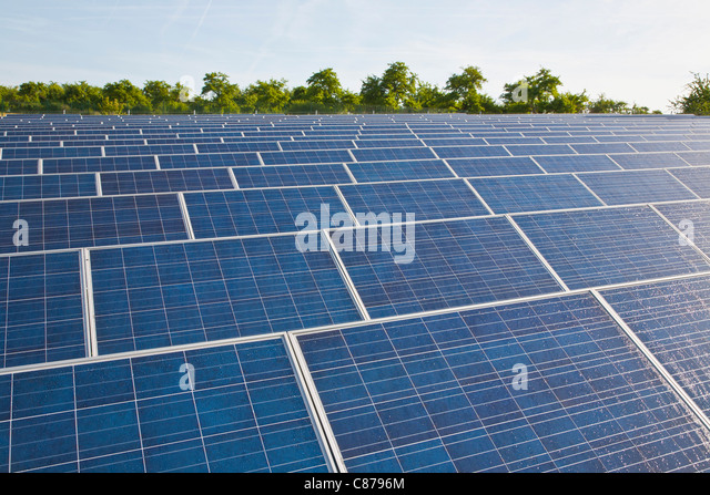 Germany, Baden-Wurttemberg, Winnenden, View of large number of solar panels at solar power plant field - Stock Image