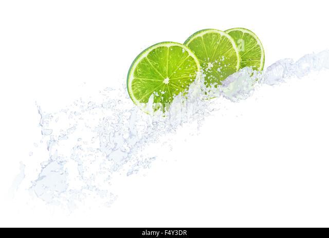 Water splashing against lime fruit slices - Stock-Bilder