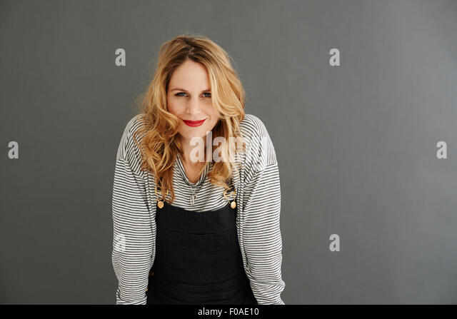 Portrait of mid adult woman looking at camera - Stock Image