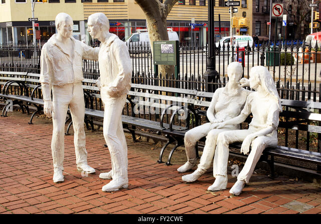 White plaster sculptures of two homosexual couples in park. 'Gay Liberation' sculpture by George Segal. - Stock-Bilder