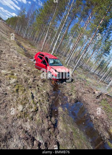 Crashed Volkswagen Golf at roadside ditch , Finland - Stock Image