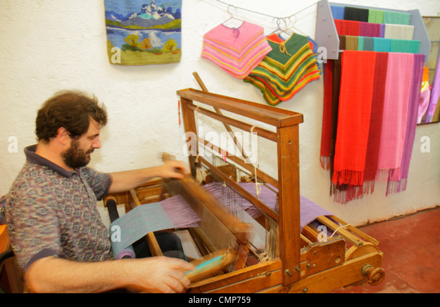 Santiago Chile Las Condes Plaza los Dominicos shopping souvenir gift shop decor handicrafts Hispanic man artisan - Stock Image