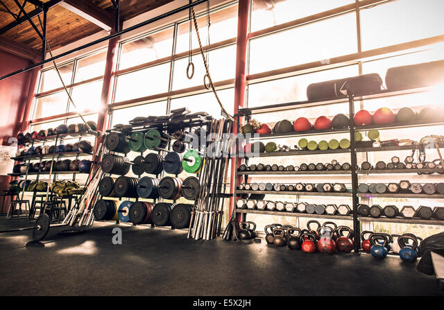 Gym equipment - weights, gym balls, kettle bells - Stock Image