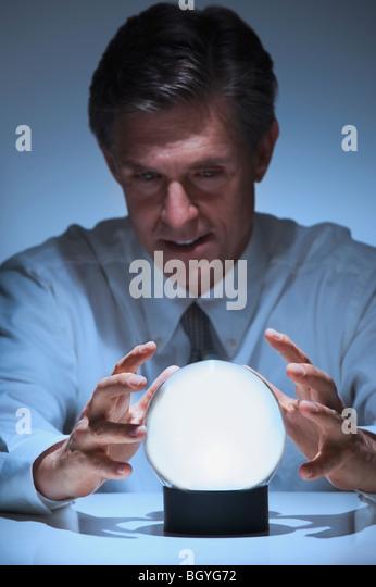 Businessman telling fortune - Stock Image