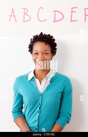 Portrait of a female preschool teacher - Stock Image