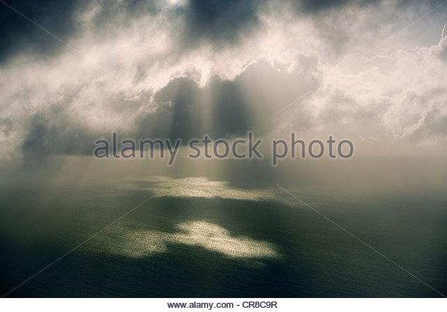 Sun rays through a storm, Turks and Caicos Islands, Caribbean, UK - Stock Image