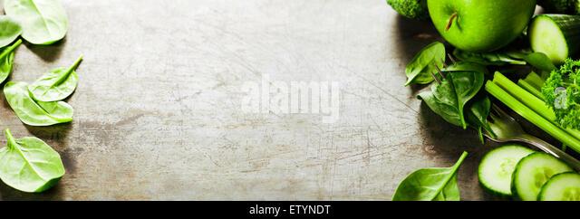 Fresh green vegetables on vintage background - detox, diet or healthy food concept - Stock Image