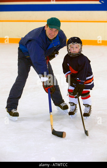 A coach and young hockey player - Stock Image