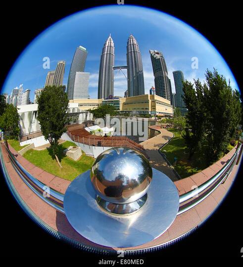 Fisheye view of the Petronas Twin Towers at KLCC in Kuala Lumpur, Malaysia - Stock Image
