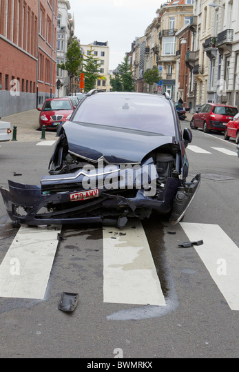 crash crashed car vehicle motor citroen smash prang accident collision fender bender street pedestrian crossing - Stock Image