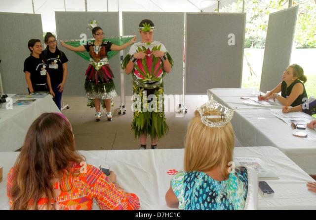 Miami Coral Gables Miami Florida Fairchild Botanical Tropical Garden teen student boy Hispanic recycled biological - Stock Image