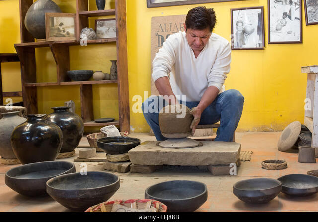 San Bartolo Coyotepec, Mexico - Javier Nieto Castillo demonstrates the making of black pottery at the Doña - Stock Image