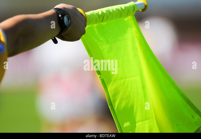 A LINESMAN HOLD FLAG UP DURING A RUGBY UNION MATCH. Photo Alan Edwards - Stock Image