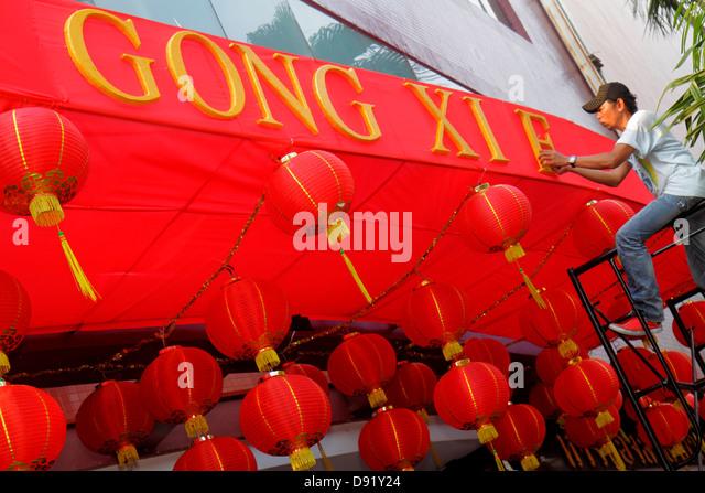 Bangkok Thailand Samphanthawong Chinatown Grand China Hotel Chinese New Year paper lanterns Asian man job - Stock Image