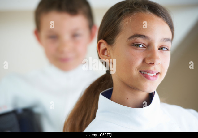 Girl wearing fencing costume - Stock Image