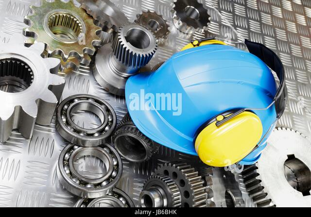 Hard hat and mechanical parts, still life. - Stock-Bilder