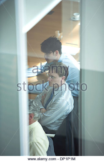 View of business people sitting in conference room - Stock Image
