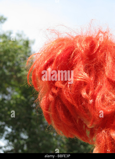 girl doll with bright red hair in city town street - Stock-Bilder