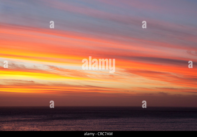 Vivid colors in sunset sky - Stock Image