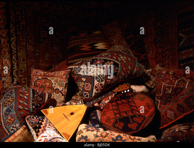 Oriental rugs and pillows with balalaika - Stock Image