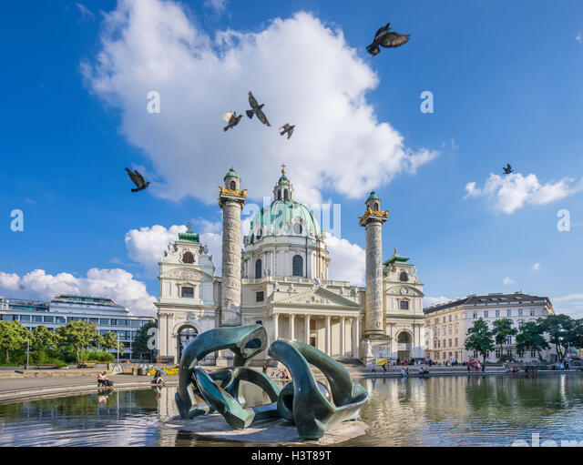 Austria, Vienna, Karlsplatz, Henry Moore sculpture in the water pool at the baroque Karlskirche (St. Charles's - Stock Image