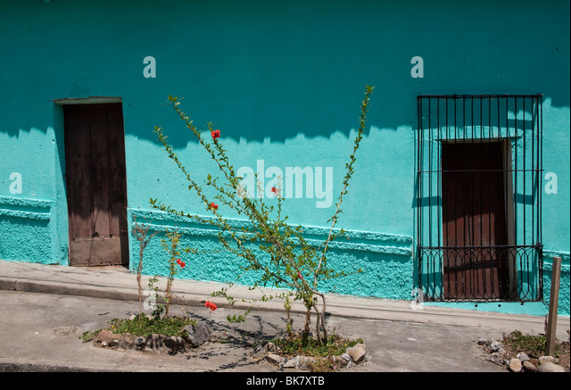 Two doors in green painted wall of a colonial house in Suchitoto El Salvador - Stock Image