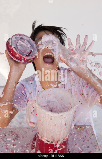 boy getting splashed by out of control overflowing blender - Stock Image