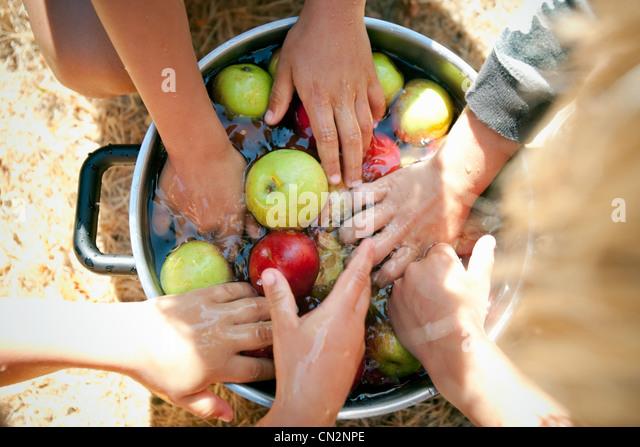 People washing apples - Stock Image