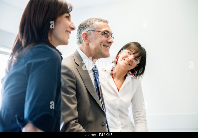 Businessman and women taking break - Stock Image