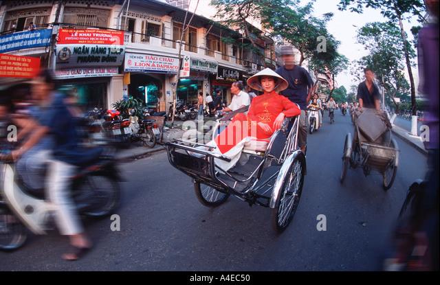 Vietnamese Woman on Rickshaw - Stock Image