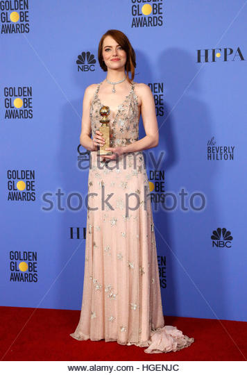 Emma Stone poses with her award for Best Performance by an Actress in a Motion Picture - Musical or Comedy for her - Stock Image