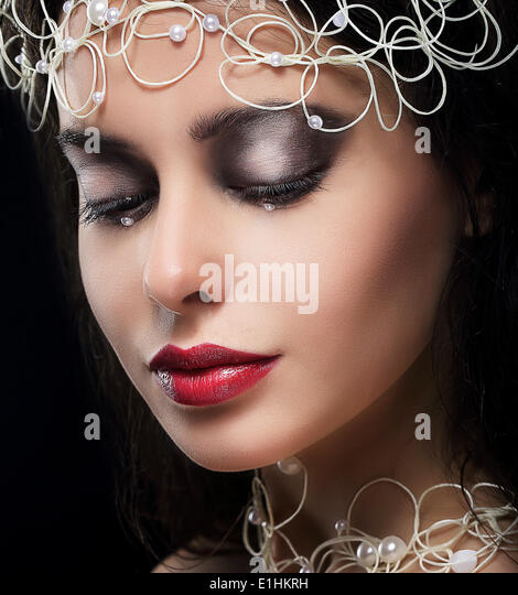 Stylish Fashionable Young Woman with Pearls in Reverie - Stock Image