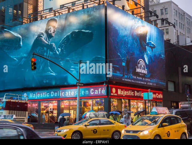 "Advertising in Times Square in New York for the summer blockbuster hit ""Jurassic World"", seen on Tuesday, - Stock Image"