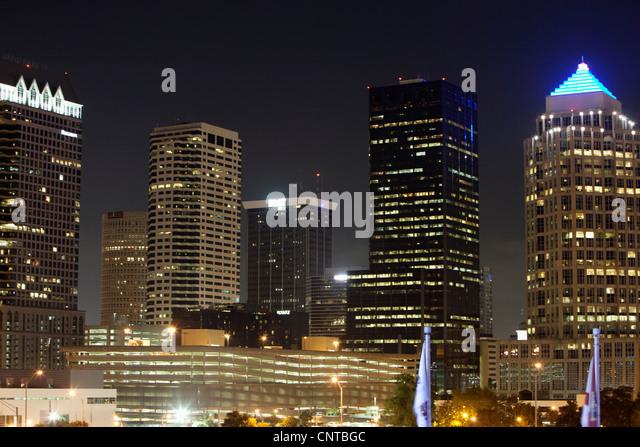 Illuminated office buildings at night - Stock Image