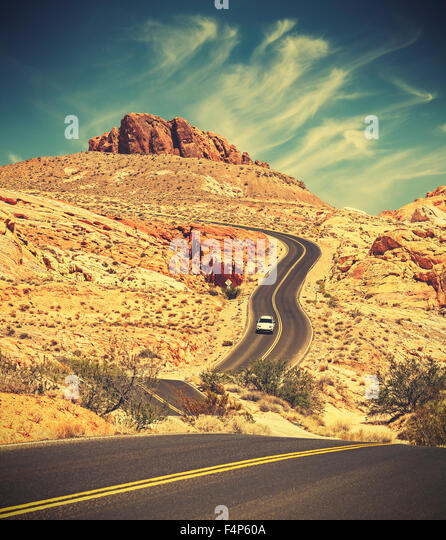 Retro toned winding desert highway, travel adventure concept, Valley of Fire State Park, Nevada, USA. - Stock-Bilder