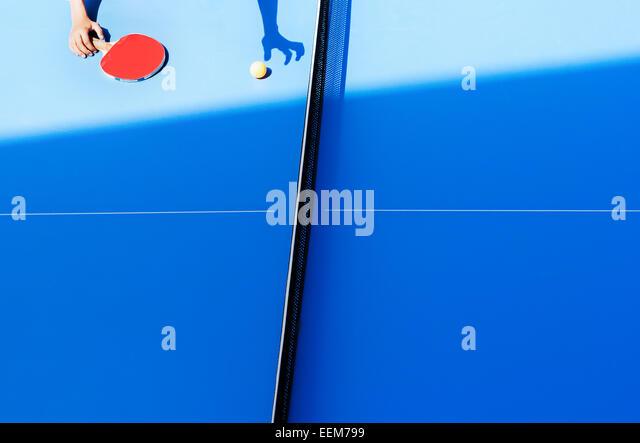 Human hand on tennis table - Stock Image