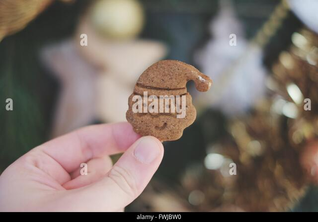 Cropped Image Of Hand Holding Cookies - Stock Image