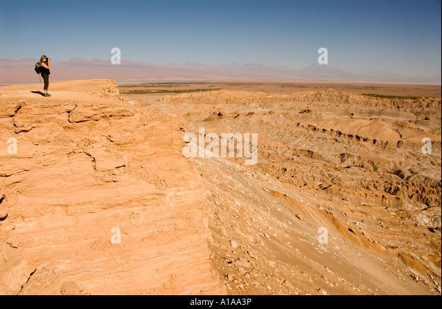 Chile Atacama desert Cari valley woman standing at edge of cliff - Stock Image