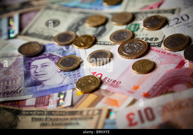 Sterling, dollar and euro bank notes and coins - Stock Image