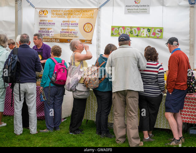 Visitors sampling sauces and cordials at Ludlow Food Festival, Shropshire, England, UK - Stock Image