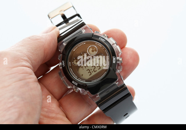 Human hand holding wrist watch, close up - Stock Image