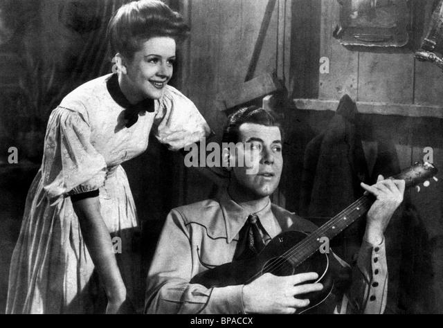 SALLY BLANE & JACK LUDEN SHOOTIN IRONS (1927) - Stock Image