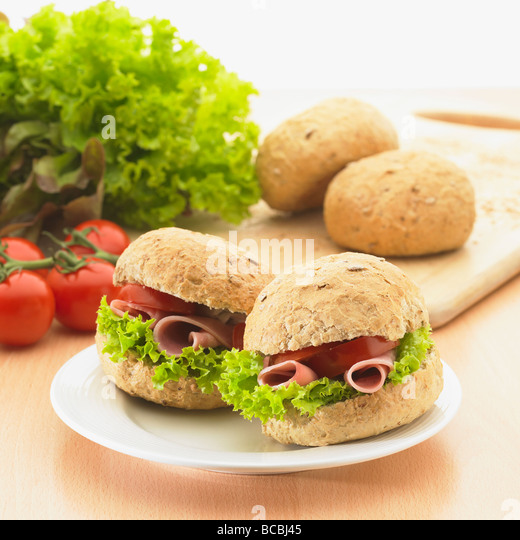Healthy wholemeal roll sandwich snack. - Stock Image