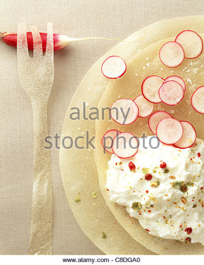 Radishes and salted whipped cream on filo pastry - Stock Image