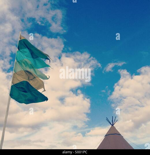 Tent and flags at a festival - Stock-Bilder