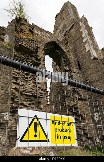 Warning about anti climb paint used on railings at Neath Abbey ruins, Neath, Glanmorgan, Wales, UK - Stock Image