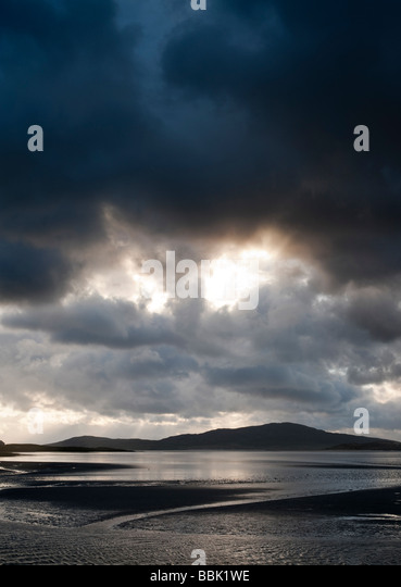 Sunset and storm clouds over Isle of Harris, Luskentyre beach, Outer Hebrides, Scotland - Stock Image